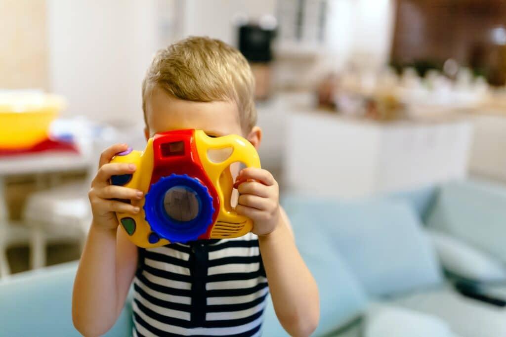 cute-boy-becoming-photographer